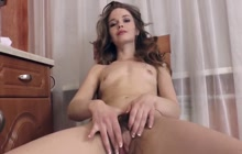 Flat chested Miranda rubs hairy pussy!