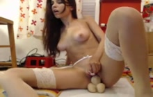 Small boobed teen riding a toy